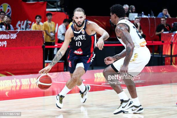 Evan Fournier of the France National Team in action against Dar Tucker of the Jordan National Team during the 1st round of 2019 FIBA World Cup at...