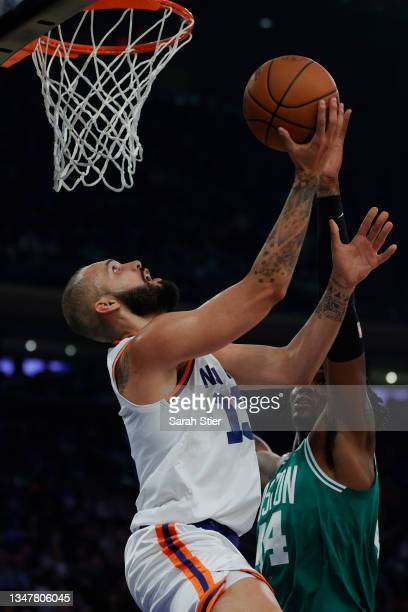 Evan Fournier of the New York Knicks goes to the basket as Robert Williams III of the Boston Celtics defends during the first half at Madison Square...