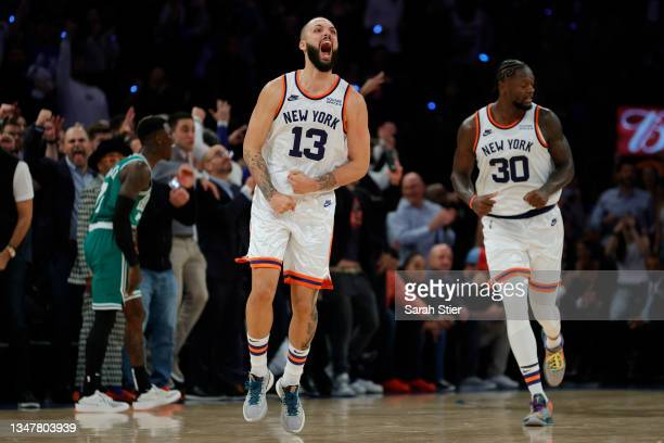 Evan Fournier of the New York Knicks reacts after making a three-point basket during second overtime against the Boston Celtics at Madison Square...
