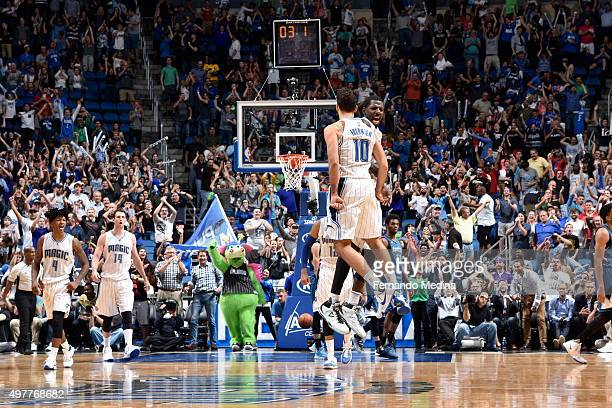 Evan Fournier of the Orlando Magic celebrates with his teammates after hitting the game winning shot against the Minnesota Timberwolves on November...