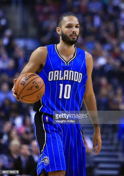 Evan Fournier of the Orlando Magic dribbles the ball during the first half of an NBA game against the Toronto Raptors at Air Canada Centre on March...
