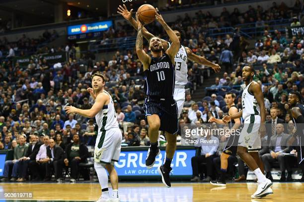 Evan Fournier of the Orlando Magic drives to the basket against Sterling Brown of the Milwaukee Bucks during the second half of a game at the Bradley...