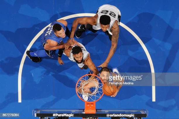 Evan Fournier of the Orlando Magic drives to the basket against the San Antonio Spurs on October 27 2017 at Amway Center in Orlando Florida NOTE TO...