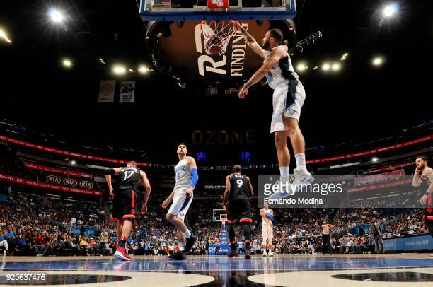 Evan Fournier of the Orlando Magic dunks the ball during the game against the Toronto Raptors on February 28 2018 at Amway Center in Orlando Florida...