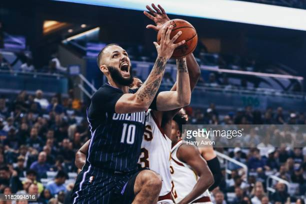 Evan Fournier of the Orlando Magic fights his way into the key against the Cleveland Cavaliers in the 1st quarter at Amway Center on October 23 2019...