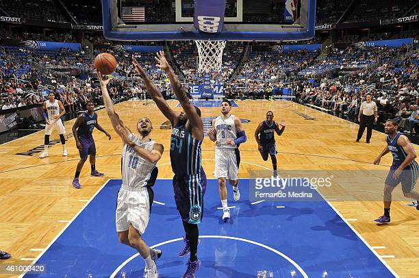 Evan Fournier of the Orlando Magic goes to the basket against Jason Maxiell of the Charlotte Hornets on January 3 2015 at Amway Center in Orlando...