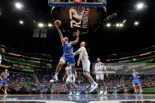 Evan Fournier of the Orlando Magic goes to the basket against the Charlotte Hornets on February 14 2019 at Amway Center in Orlando Florida NOTE TO...