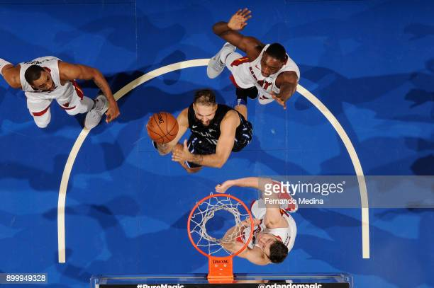 Evan Fournier of the Orlando Magic goes to the basket against the Miami Heat on December 30 2017 at Amway Center in Orlando Florida NOTE TO USER User...