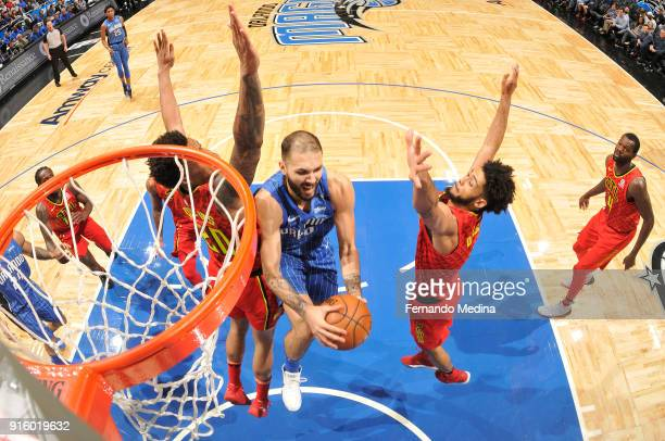 Evan Fournier of the Orlando Magic goes to the basket against the Atlanta Hawks on February 8 2018 at Amway Center in Orlando Florida NOTE TO USER...