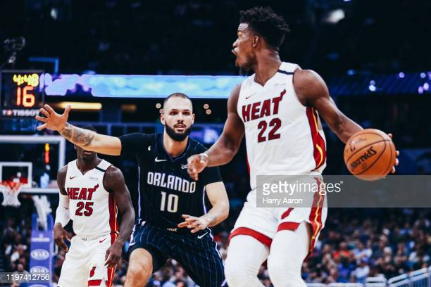 Evan Fournier of the Orlando Magic guards Jimmy Butler of the Miami Heat in the second quarter at Amway Center on January 03, 2020 in Orlando,...