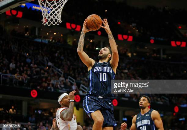 Evan Fournier of the Orlando Magic lays one in against Isaiah Thomas of the Cleveland Cavaliers at Quicken Loans Arena on January 18 2018 in...