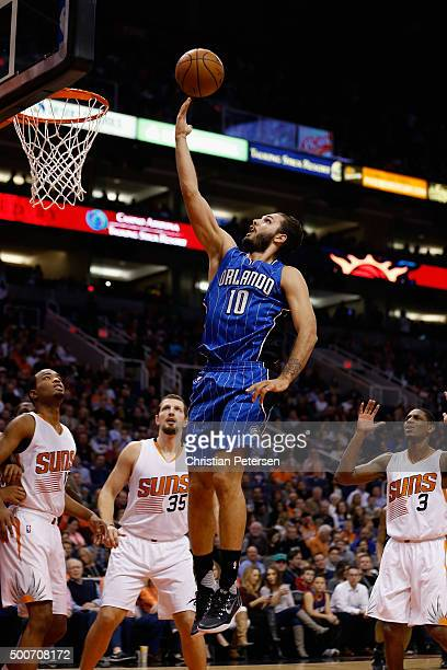 Evan Fournier of the Orlando Magic lays up a shot against the Phoenix Suns during the first half of the NBA game at Talking Stick Resort Arena on...