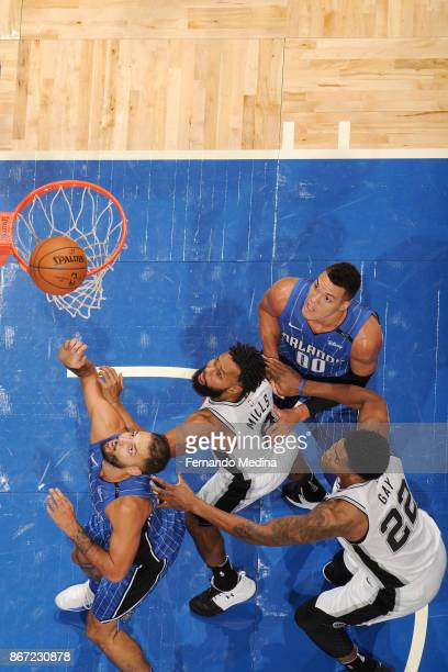 Evan Fournier of the Orlando Magic Patty Mills of the San Antonio Spurs Aaron Gordon of the Orlando Magic and Rudy Gay of the San Antonio Spurs await...