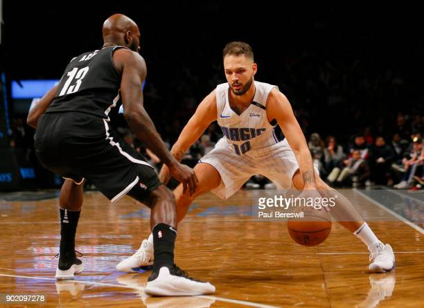 Evan Fournier of the Orlando Magic puts a move on to try to pass Quincy Acy of the Brooklyn Nets in an NBA basketball game on January 1 2018 at...