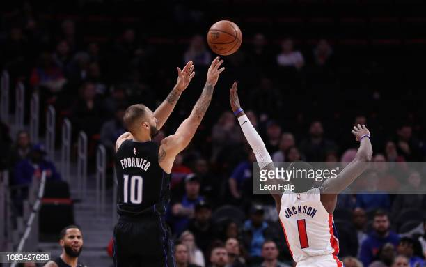 Evan Fournier of the Orlando Magic shoots a three point shot as ]d1] defends during the fourth quarter of the game at Little Caesars Arena on January...