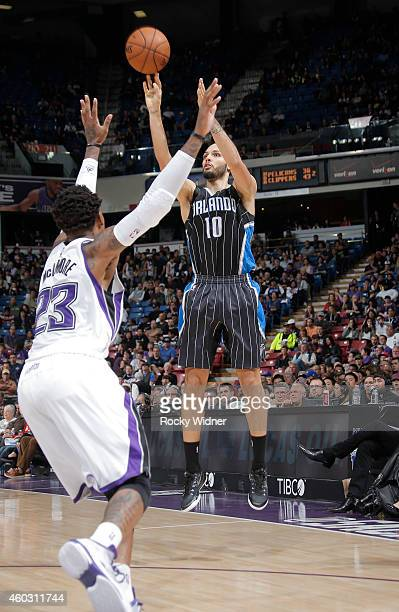 Evan Fournier of the Orlando Magic shoots a three pointer against Ben McLemore of the Sacramento Kings on December 6 2014 at Sleep Train Arena in...