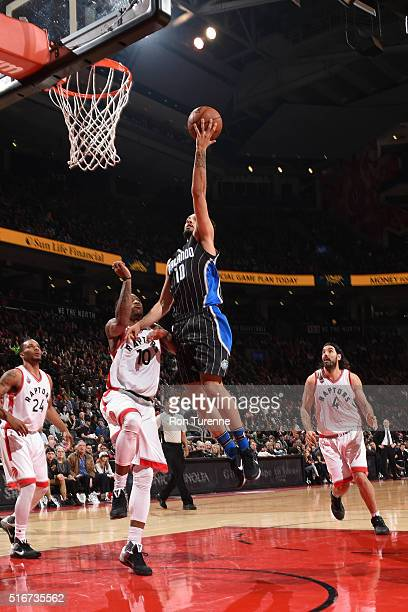 Evan Fournier of the Orlando Magic shoots the ball against the Toronto Raptors on March 20 2016 at the Air Canada Centre in Toronto Ontario Canada...