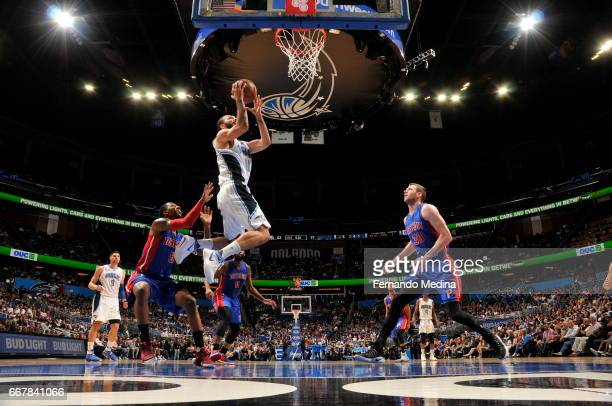 Evan Fournier of the Orlando Magic shoots the ball against the Detroit Pistons on April 12 2017 at the Amway Center in Orlando Florida NOTE TO USER...