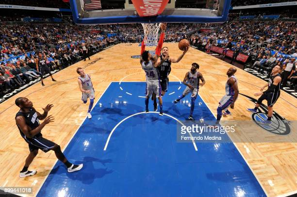 Evan Fournier of the Orlando Magic shoots the ball against the Detroit Pistons on December 28 2017 at Amway Center in Orlando Florida NOTE TO USER...