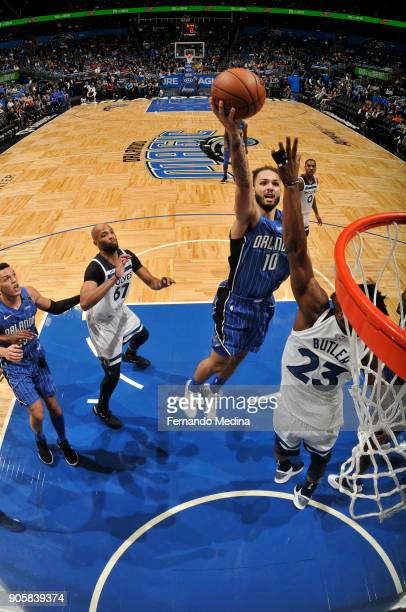Evan Fournier of the Orlando Magic shoots the ball against the Minnesota Timberwolves on January 16 2018 at Amway Center in Orlando Florida NOTE TO...