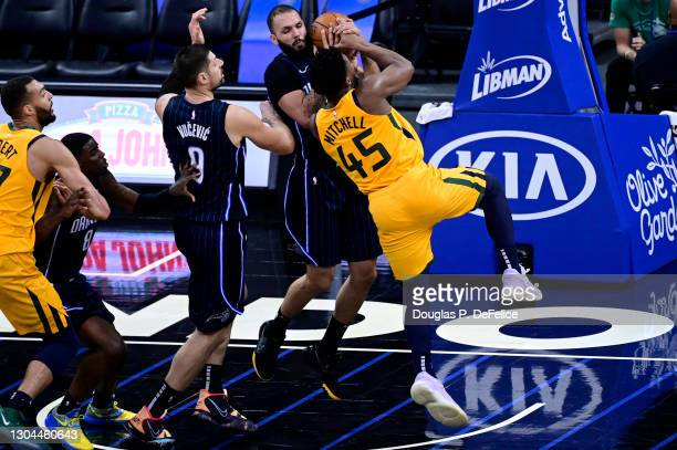 Evan Fournier of the Orlando Magic steals the ball from Donovan Mitchell of the Utah Jazz during the third quarter at Amway Center on February 27,...