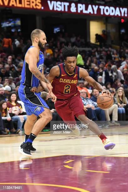 Evan Fournier of the Orlando Magic tries to guard Collin Sexton of the Cleveland Cavaliers during the second half at Quicken Loans Arena on March 03...