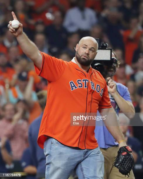 Evan Gattis acknowledges the crowd prior to Game One of the 2019 World Series between the Houston Astros and the Washington Nationals at Minute Maid...