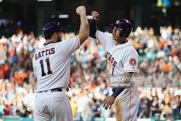 Evan Gattis and Carlos Correa of the Houston Astros celebrate after Evan Gattis hit a three-run home run in the second inning of their game against...