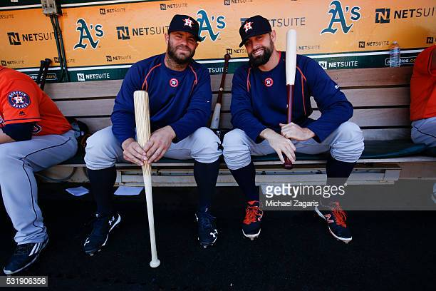 Evan Gattis and Pat Neshek of the Houston Astros sit in the dugout prior to the game against the Oakland Athletics at the Oakland Coliseum on May 1...