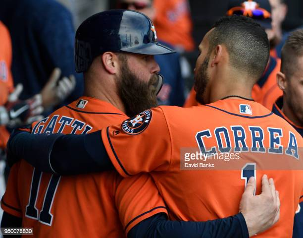Evan Gattis is greeted by Carlos Correa of the Houston Astros after hitting a home run against the Chicago White Sox during the ninth inning on April...
