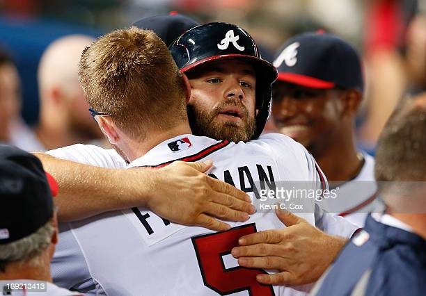 Evan Gattis of the Atlanta Braves celebrates his solo homer in the bottom of the ninth that tied the game 4-4 against the Minnesota Twins with...