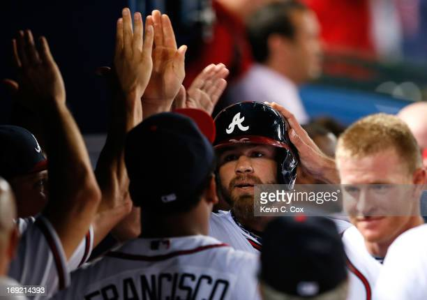 Evan Gattis of the Atlanta Braves celebrates his solo homer in the bottom of the ninth that tied the game 44 against the Minnesota Twins at Turner...