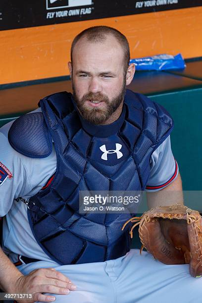 Evan Gattis of the Atlanta Braves sits in the dugout before the game against the San Francisco Giants at ATT Park on May 13 2014 in San Francisco...