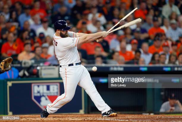 Evan Gattis of the Houston Astros breaks his bat in the fourth inning against the Boston Red Sox during game one of the American League Division...