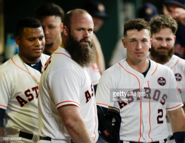 Evan Gattis of the Houston Astros celebrates his two-run home run in the fourth inning against the Minnesota Twins with his teammates in the dugout...