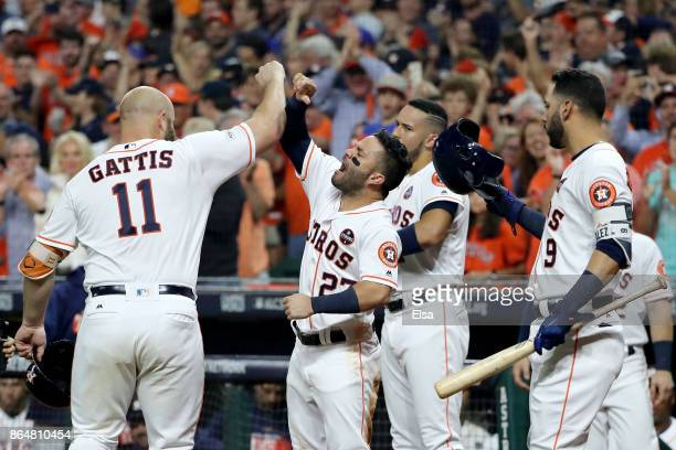 Evan Gattis of the Houston Astros celebrates with Jose Altuve Carlos Correa and Marwin Gonzalez after hitting a solo home run against CC Sabathia of...