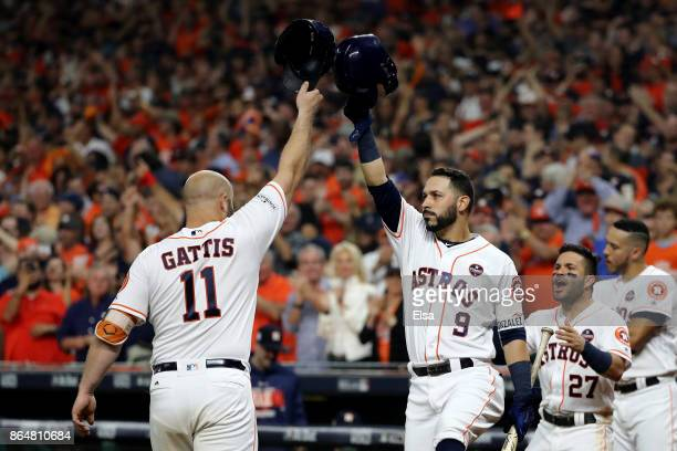 Evan Gattis of the Houston Astros celebrates with Marwin Gonzalez Jose Altuve and Carlos Correa after hitting a solo home run against CC Sabathia of...