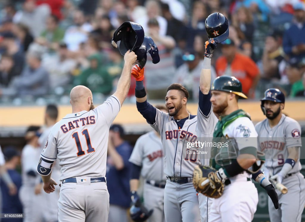 Evan Gattis #11 of the Houston Astros celebrates with Yuli Gurriel #10 and Josh Reddick #22 after he hit a three-run home run against the Oakland Athletics in the second inning at Oakland Alameda Coliseum on June 13, 2018 in Oakland, California.