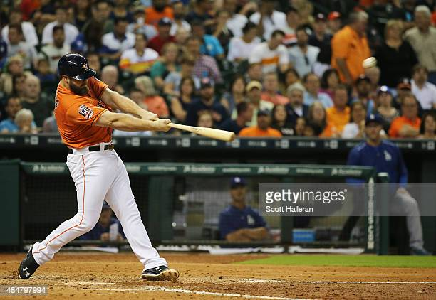 Evan Gattis of the Houston Astros connects on a solo home run in the sixth inning during their game against the Los Angeles Dodgers at Minute Maid...