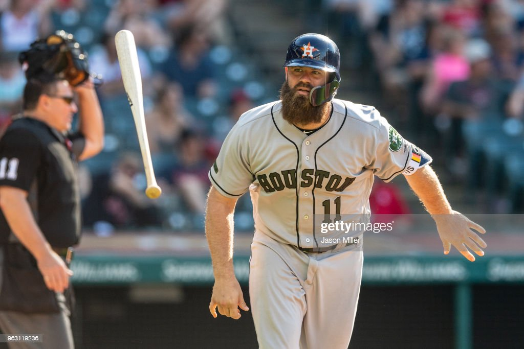 Evan Gattis #11 of the Houston Astros flips his bat after hitting a solo home run in the 13th inning against the Cleveland Indians at Progressive Field on May 27, 2018 in Cleveland, Ohio.