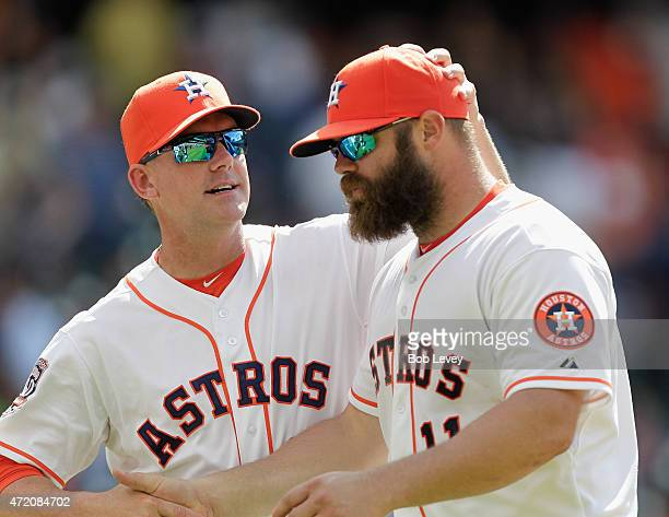 Evan Gattis of the Houston Astros gets a pat on the head from Manager AJ Hinch as the Houston Astros defeated the Seattle Mariners 76 at Minute Maid...
