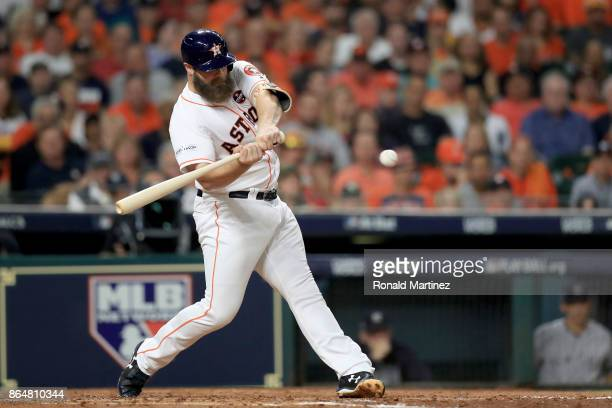 Evan Gattis of the Houston Astros hits a a solo home run against CC Sabathia of the New York Yankees during the fourth inning in Game Seven of the...