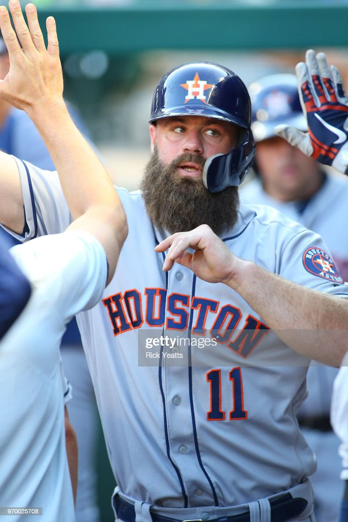 Evan Gattis #11 of the Houston Astros is congratulated for scoring in the in the second inning against the Texas Rangers at Globe Life Park in Arlington on June 8, 2018 in Arlington, Texas.