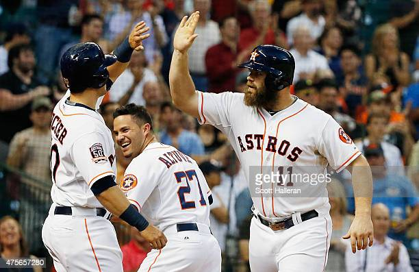 Evan Gattis of the Houston Astros is greeted by Preston Tucker after Gattis hit a three-run home run in the third inning during their game against...