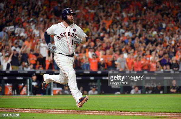 Evan Gattis of the Houston Astros is out on a sac fly in the bottom of the eighth inning Game 6 of the American League Championship Series against...