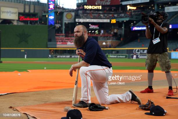 Evan Gattis of the Houston Astros looks on during batting practice prior to Game 1 of the ALDS against the Cleveland Indians at Minute Maid Park on...