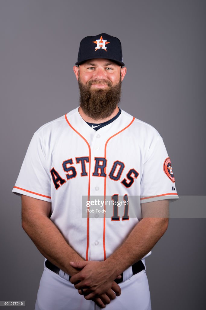 Evan Gattis #11 of the Houston Astros poses during Photo Day on Wednesday, February 21, 2018 at the Ballpark of the Palm Beaches in West Palm Beach, Florida.
