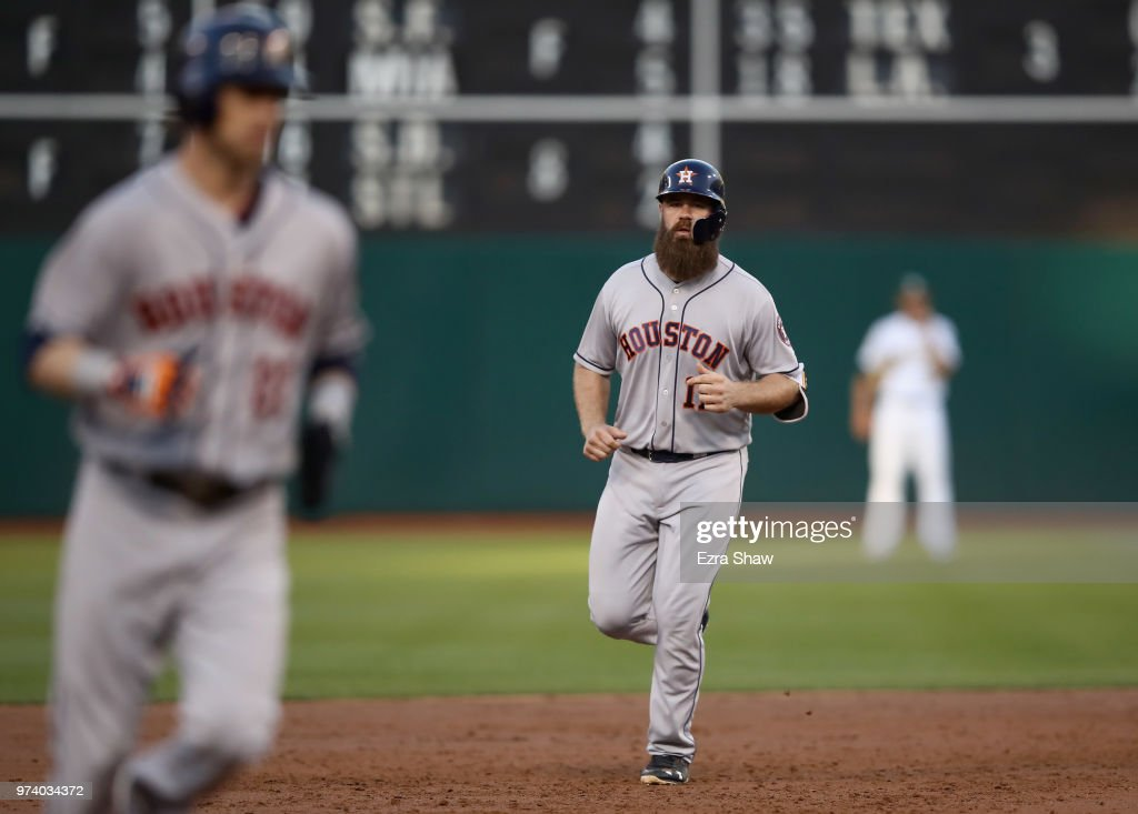 Evan Gattis #11 of the Houston Astros rounds the bases after he hit a three-run home run against the Oakland Athletics in the second inning at Oakland Alameda Coliseum on June 13, 2018 in Oakland, California.