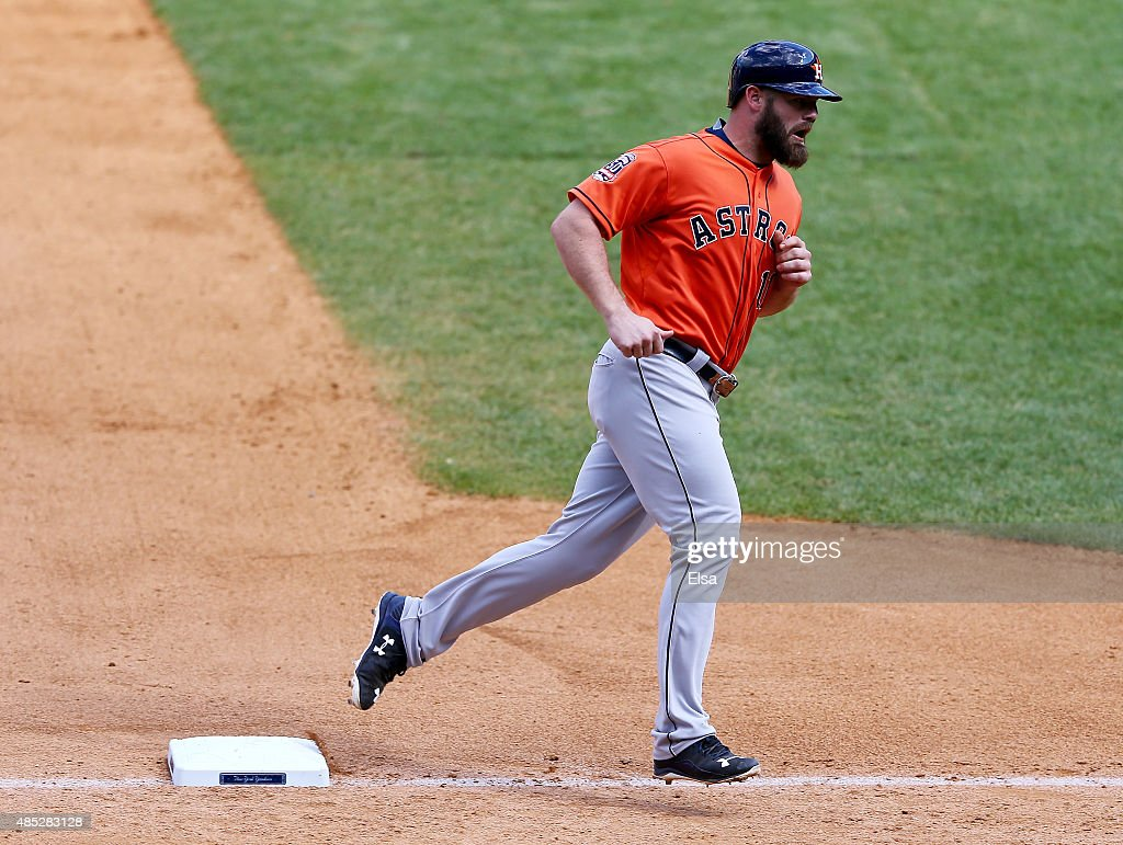 Evan Gattis #11 of the Houston Astros rounds third base after his home run in the eighth inning against the New York Yankees on August 26, 2015 at Yankee Stadium in the Bronx borough of New York City.