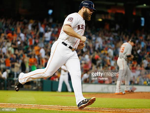 Evan Gattis of the Houston Astros runs to first base after hitting a three-run home run in the third inning off Mike Wright of the Baltimore Orioles...